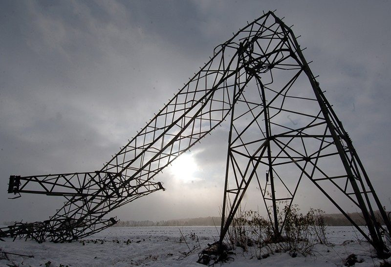Picture shows a bent power pole.